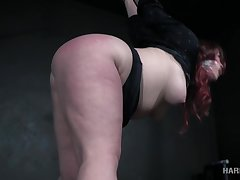 Voluptuous redheaded complain with a big ass gets punished by her bondage dab hand