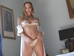 Classy mature solo amateur MILF model Eve strips sensually