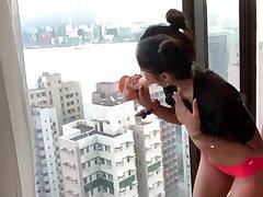 Misbehaving DESI COLLEGE TEEN RIDES DILDO AGAINST HONG KONG SKYSCRAPER WINDOW